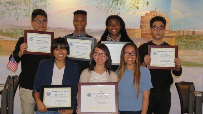 Students of the Month pose with their award certificates. Front row: Jhoanna Garcia, Yanqing Liang, and Club Adviser Alexandra Pereira. Back row: Brendan Cheung, Kevin Forrester, Nikita Forrester and Fares Okhouli.