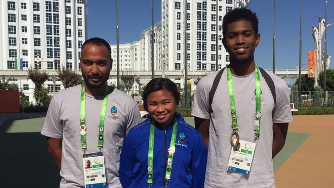 Team Guam Athletics, from left, Desmond Mandell, coach, Shania Bulala, 60m sprinter, and Athan Arizanga, 400m sprinter.