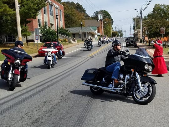 Bikers riding into Erin Court Square are greeted by