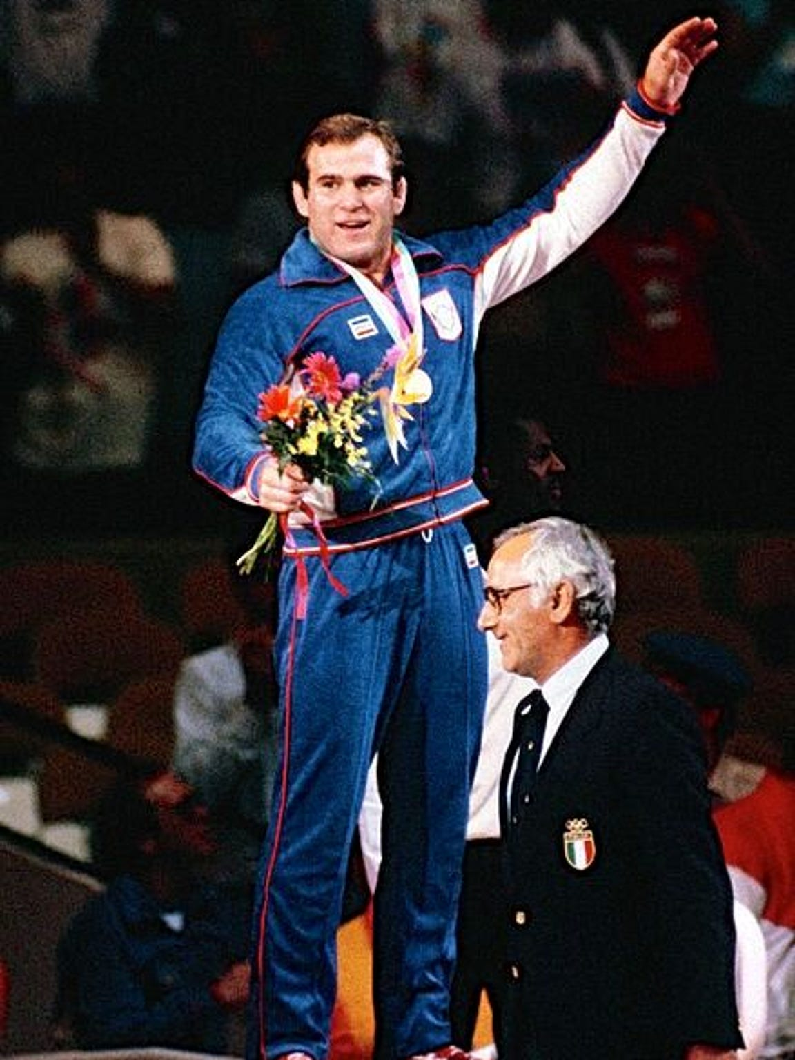 Wrestler Ed Banach accepts his gold medal during the