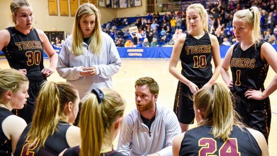 Harrisburg head coach Nick Mayer talks to his team