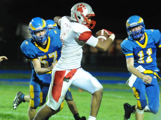 St. Joseph's Sencere Tapp runs for a touchdown after intercepting the ball late in the fourth quarter against Pennsville on Friday.