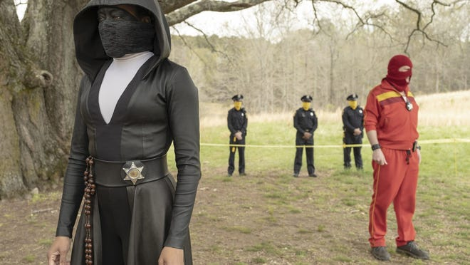 """Regina King in a scene from """"Watchmen."""" The series is nominated for 26 Emmy Awards including one for outstanding limited series."""