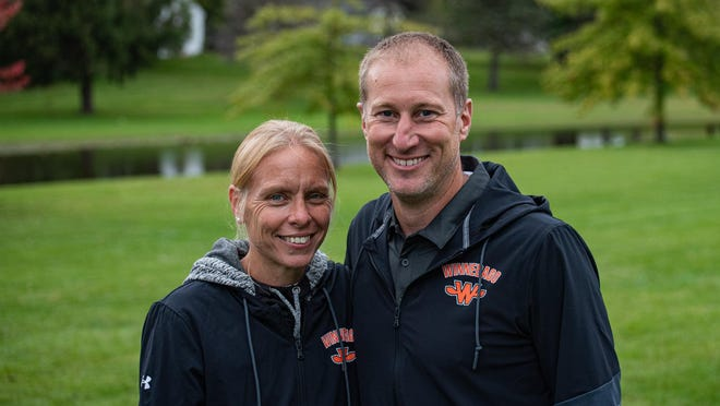 Janet, left, and Joe Erb smile before a recent cross country meet. The couple were recently inducted into the ITCCCA Hall of Fame.