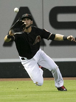 Diamondbacks outfielder David Peralta makes a catch during the third inning of the major league baseball game against the Mets at Chase Field in Phoenix on Saturday, June 6, 2015.