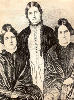 """The Fox sisters, who claimed to be able to communicate with a dead peddlar through a system of """"knockings."""" From left to right, Margaretta, Katherine and Leah. Margaretta and Katherine claimed the power to converse with the dead; Leah, who lived in Rochester, brought them here to promote her sisters."""