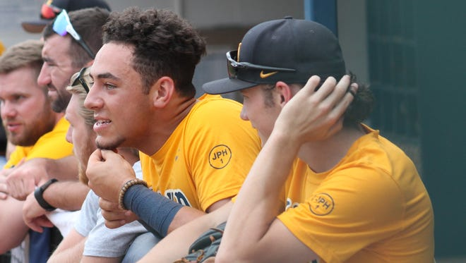 Former New Richmond teammates Zade Richardson (left leaning over dugout) and Lane Flamm (right) are reunited this summer on the Midland Redskins.