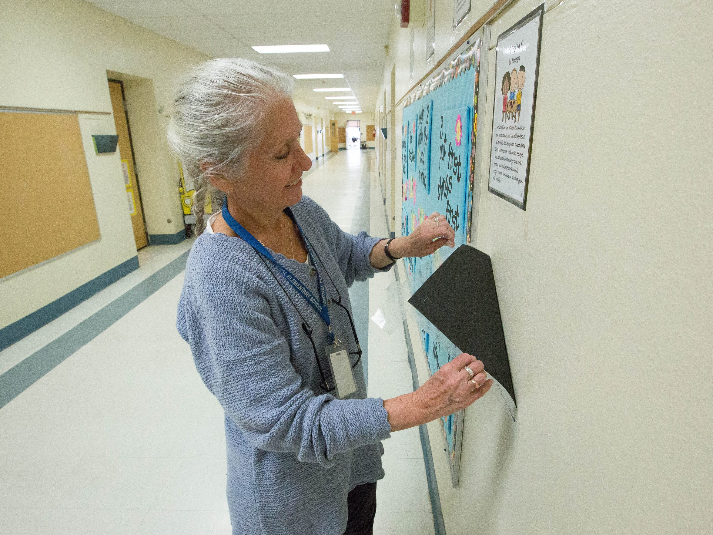 Eunice Zemek, the Title I instructional specialist at Central Elementary, pulls posters from the walls of the empty school, Thursday January 18, 2018. The students at the school were moved to St. Paul's United Methodist Church and the Las Cruces Boys and Girls Club while Central Elementary is cleaned of mold that was found recently.