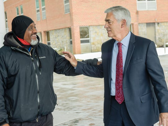 John Lloyd, president and CEO of Meridian Health, greets valet Willie Williams (left) of Nationwide Valet Service at Jersey Shore University Medical Center in Neptune.