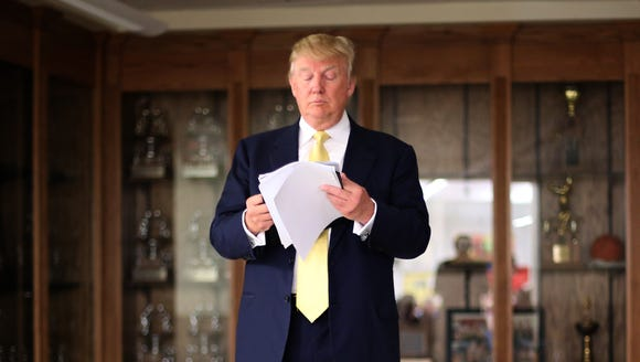 Donald Trump prepares to speak from a cafeteria at