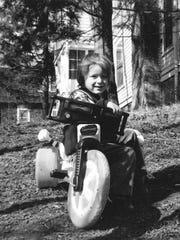 A 1979 photograph taken by Cornell graduate Gregory Tate. Tate took the photo for a class assignment and is hoping to find the boy featured in the photo to share the images with him