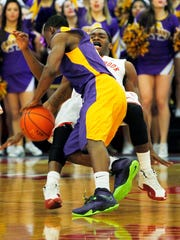Mar 15, 2014; Stony Brook, NY, USA; Albany Great Danes guard DJ Evans (3) is called for a charging foul against Stony Brook Seawolves guard Dave Coley (5) in the championship game of the America East college basketball tournament at Pritchard Gym. Mandatory Credit: Andy Marlin-USA TODAY Sports