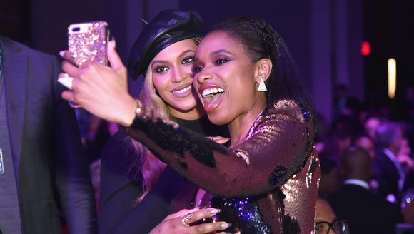 Beyoncé and Jennifer Hudson pose together at the Clive