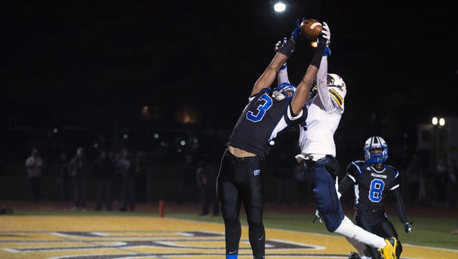 Eric Smith comes up with an interception against Toms River North in last year's South Jersey Group 5 championship game. Smith is now enrolled at Timber Creek High School and pending paper work, will play for the Chargers.
