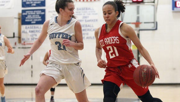 North Rockland's Naya Rivera (21) drives to the basket