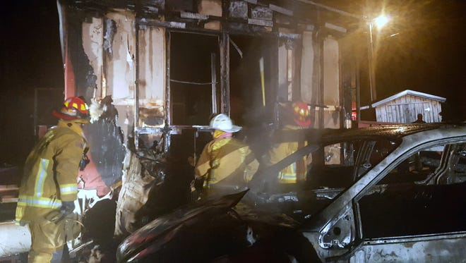 Firefighters battle a mobile home blaze early Saturday morning in the Town of Bath.