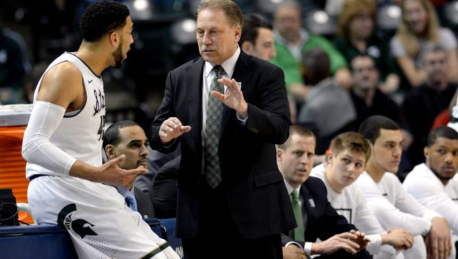 Michigan State coach Tom Izzo talks to senior guard Denzel Valentine (45) after talking him out of the game during the first half of MSU's Big Ten tournament over Ohio State Friday night in Indianapolis.