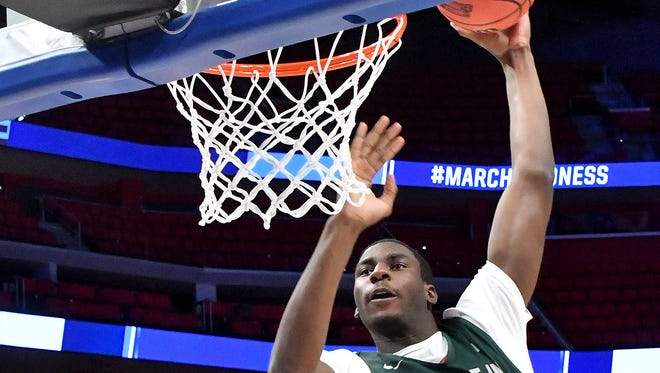 Jaren Jackson towers over the rim before dunking to the delight of the crowd on Thursday at Little Caesars Arena.