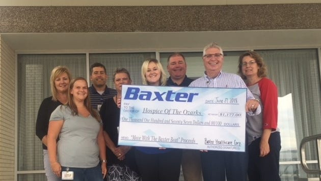 """Baxter Healthcare recently donated more than $1,100 to Hospice of the Ozarks. Money for the donation was collected by Baxter Healthcare employees during the """"Move to the Baxter Beat"""" race."""