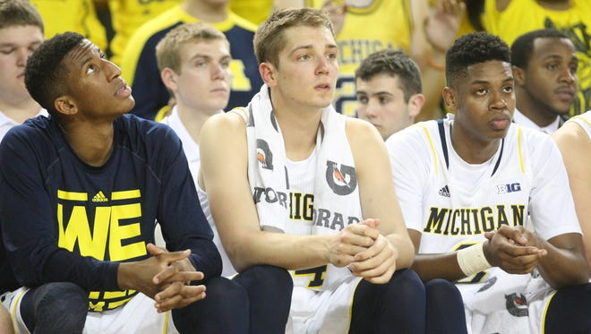 Michigan's Aubrey Dawkins, Mark Donnal and Kameron Chatman on the bench during second-half action against Wayne State on November 10, 2014.