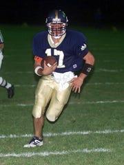 Pat Manuel runs for a touchdown for Elmira Notre Dame