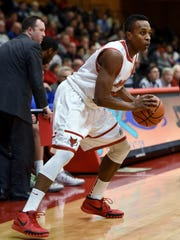 Marist College's Manny Thomas readies to drive against