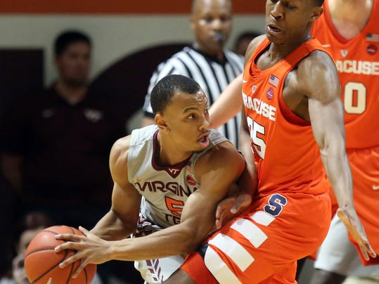 Virginia Tech's Justin Robinson (5) looks to pass around Syracuse defender Tyrus Battle (25) during the first half of an NCAA college basketball game in Blacksburg, Va., Tuesday, Jan. 10 2017. (Matt Gentry/The Roanoke Times via AP)