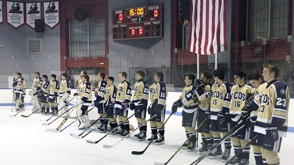 RCDS hockey stands for pregame ceremony prior to Wednesday's