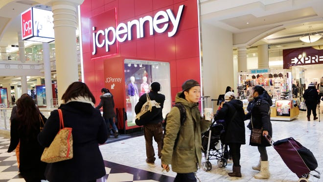 Shoppers visit a J.C. Penney store in New York, Feb. 19, 2015.
