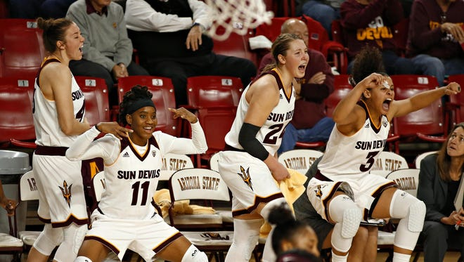 The ASU bench erupts after a score late in the second half in a win against Florida State University at Wells Fargo Arena in Tempe on December 21, 2015