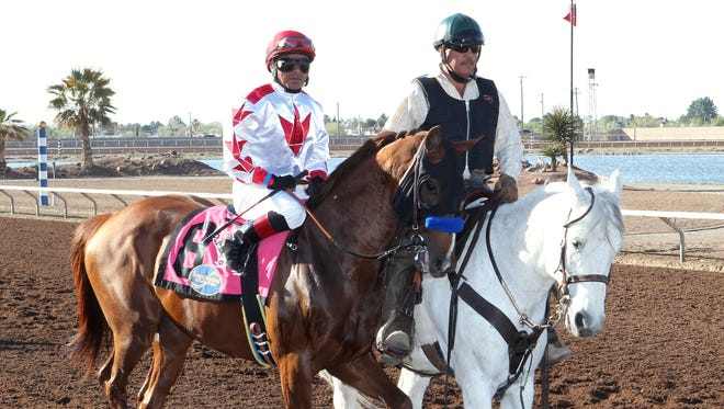 Standout rider Martin Garcia, left, on top of Collected at Sunday's Sunland Park Festival of Racing Stakes.