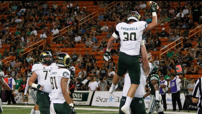 Colorado State tight end Dalton Fackrell (30) reacts with teammates after he made a touchdown during the second quarter of the NCAA college football game against Hawaii, Saturday, Sept. 30, 2017, in Honolulu. (AP Photo/Marco Garcia)