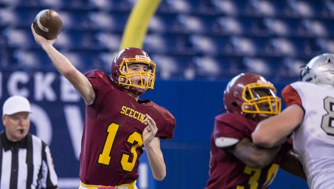 Indianapolis Scecina Memorial High School junior Mac Ayres (13) drops back to throw during the first half of IHSAA varsity football action at Lucas Oil Stadium, Friday, October 6, 2017.