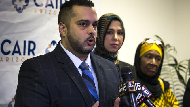 Imraan Siddiqi (left), executive director of CAIR Arizona, speaks during a press conference on June 26, 2018, at CAIR-Arizona, in Mesa. The press conference was held in reaction to the Supreme Court's decision on Trump's travel ban