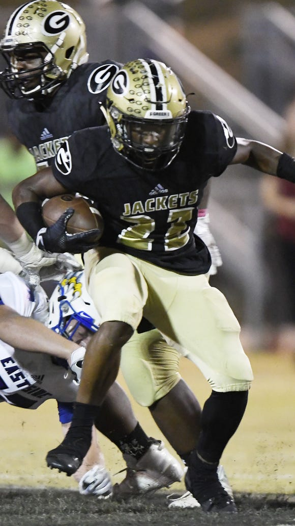 Greer's Dre Williams (22) takes off on a touchdown run  during the Yellow Jackets' 42-7 win over Eastside Friday night at Dooley Field.