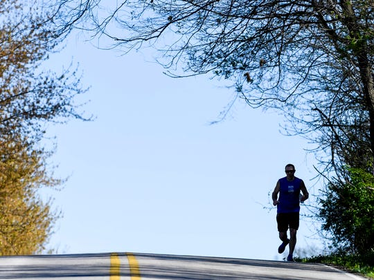 Training for the Boston Marathon, Henderson resident Paul Brantley tops a hill on Marywood Drive during his daily run Friday, April 7, 2017.