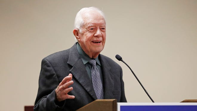 "FILE - In this Sept. 15, 2016, file photo, former President Jimmy Carter speaks at a Baptist conference in Atlanta. Carter says the U.S. functions more like an ""oligarchy than a democracy,"" and he is sharply critical of U.S. foreign policy under President Donald Trump. He made his remarks Tuesday, Sept. 12, 2017, to several hundred supporters of his post-presidency Carter Center in Atlanta. (AP Photo/David Goldman, File)"