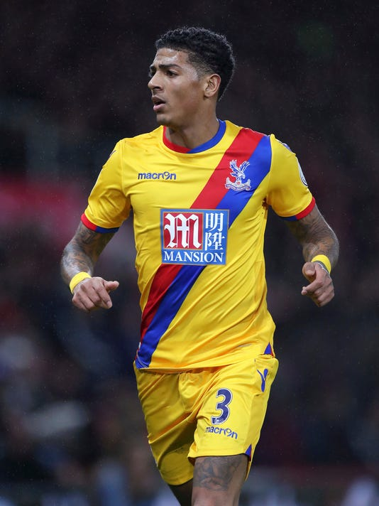 Crystal Palace's new signing Patrick van Aanholt runs during their English Premier League soccer match against AFC Bournemouth at the Vitality Stadium, Bournemouth, England, Tuesday, Jan. 31, 2017. (Andrew Matthews/PA via AP)