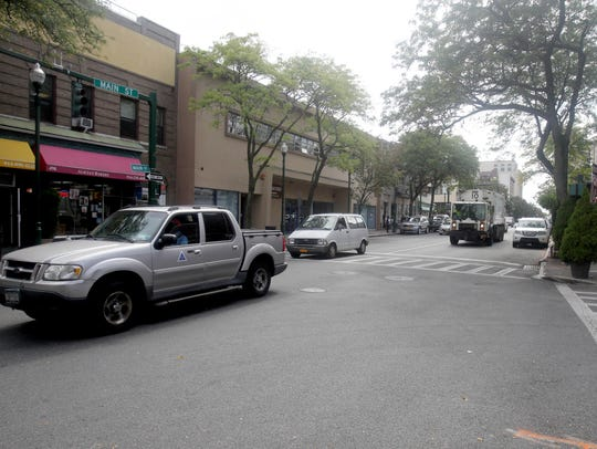 Cars drive along Main Street in New Rochelle Sept.