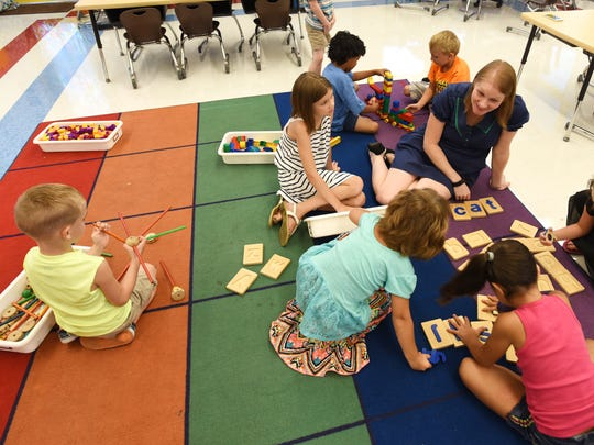 Sarah Gantzer plays with students during Zane Grey Elementary School's kindergarten jumpstart program.