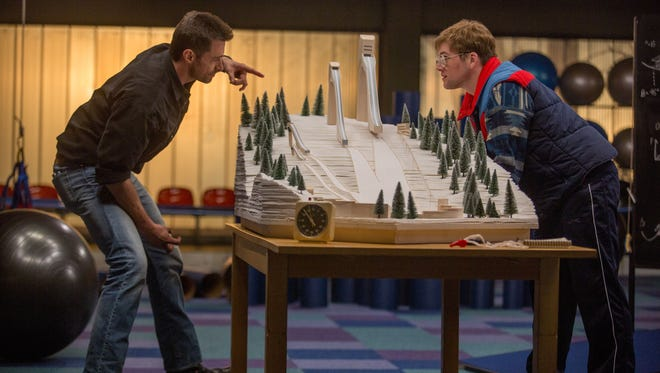 """Hugh Jackman and Taron Egerton appear in a scene from """"Eddie the Eagle."""""""