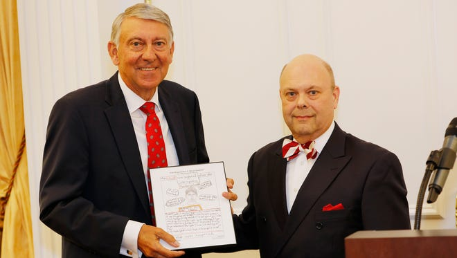 The Hon. J. Miles Sweeney, left, SMBA's Distinguished Attorney, with presenter Rick Schnake of Neale & Newman