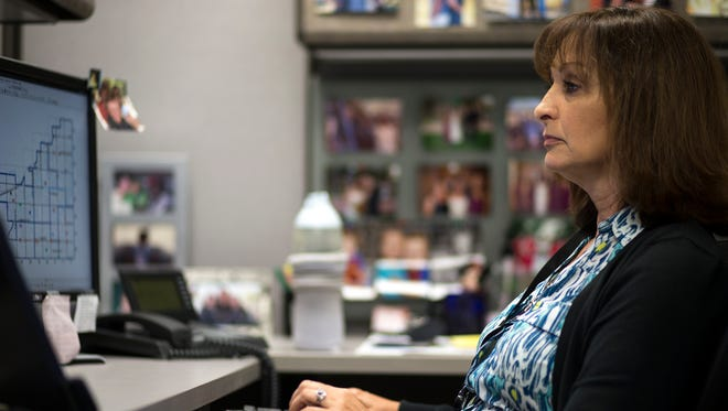 Crime analyst Jackie Pennacchio works on a computer on Oct. 20, 2016, at Mesa Police Department.