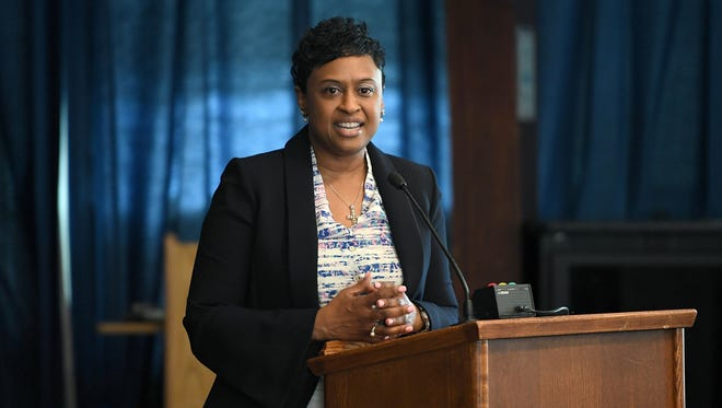 Denise Patterson addresses the crowd after being named the new superintendent of Asheville City Schools in a special board meeting at the administrative board room on Thursday, June 1, 2017.
