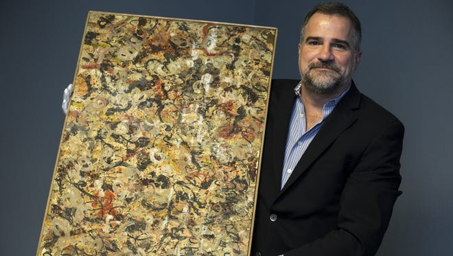 Josh Levine with an original Jackson Pollock painting, June 6, 2017, at J. Levine Auction and Appraisal, 10345 N. Scottsdale Road, Scottsdale. Levine expects the painting to sell between $10 million and $15 million.