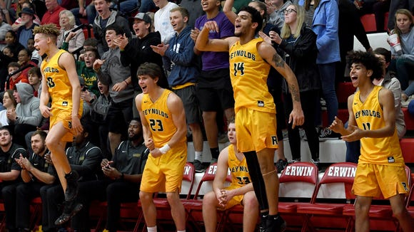 From left: Reynolds' Jalen Crowder, Andrew Stenberg, Jace Dover, and Jayreion Gragg stand and jump to celebrate the final seconds of the championship game of the WMAC tournament at Erwin High School on Friday, Feb. 16, 2018. The Rockets defeated the Blackhawks 68-52 to win the conference title.