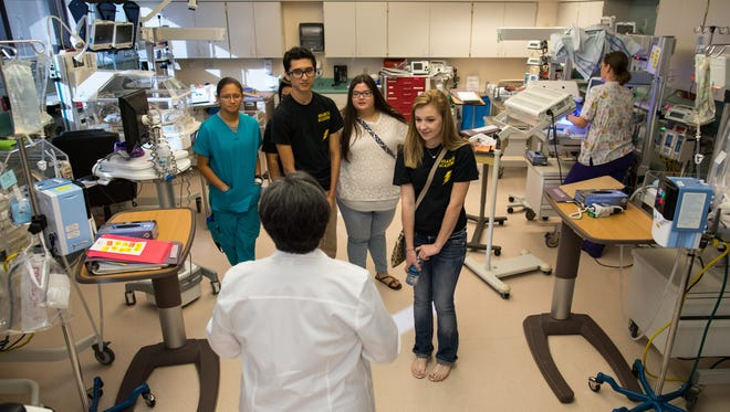 Nurse Lenora Sevcik leads a group of Branch Academy for Career and Technical Education seniors through  a tour of Christus Spohn Hospital South's neonatal intensive care unit on Thursday, May 25, 2017.