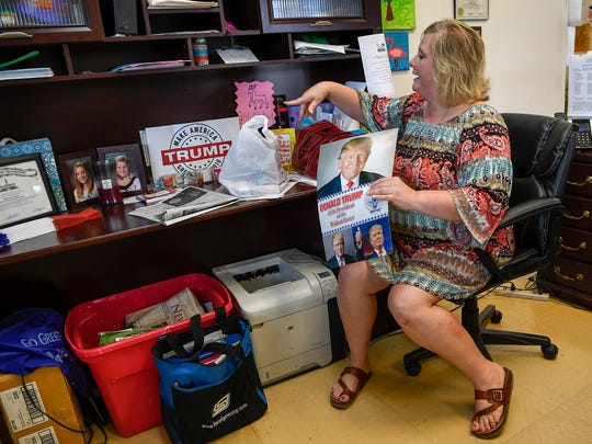 Wayne County Republican Chairwoman Stephanie Pearson shows off her poster of President Trump that she received during his Nashville visit. She is photographed in Collinwood, Tenn., Wednesday, July 12, 2017.
