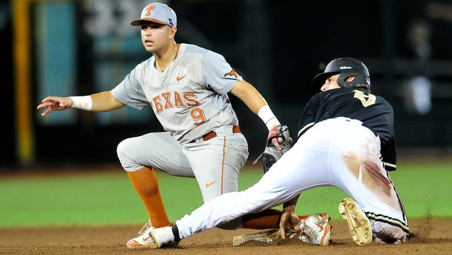 Vanderbilt's Rhett Wiseman, right, safely steals the second base as Texas' C.J. Hinojosa tags him during the 10th inning at the College World Series at TD Ameritrade Park in Omaha, Neb., Saturday, June 21, 2014.