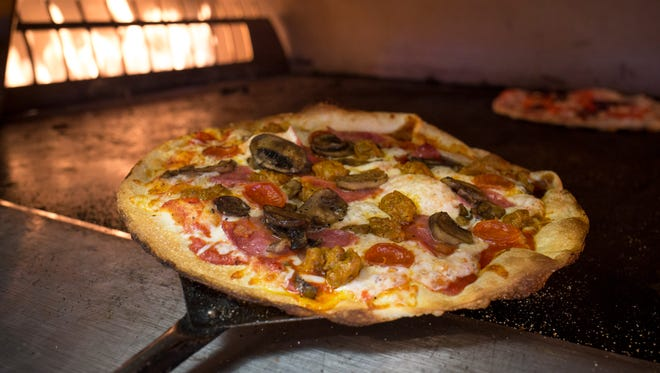 The seventh branch of Fired Pie, a locally owned, fast-casual chain, opened near AMC Ahwatukee 24 theaters. The restaurant will give away free pizza or salad to dine-in guests from 11:30 a.m. to 6 p.m. Tuesday, Oct. 7. Diners make pizzas and salads by choosing sauces and cheeses such as mozzarella, Gorgonzola and Fontina, then adding toppings such as steak, roast chicken, artichoke, mushrooms, kalamata olives and jalapeños. Pizzas take three minutes to bake.    Details: 4905 E. Ray Road, Phoenix. Other locations at firedpie.com.